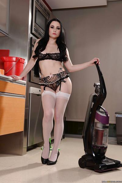 Maid Veruca James masturbates her tight vagina in the kitchen