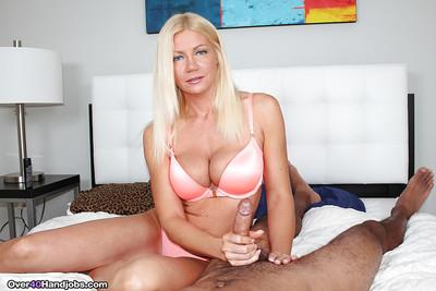 Busty over 40 blonde MILF Christina Skye giving big cock handjob