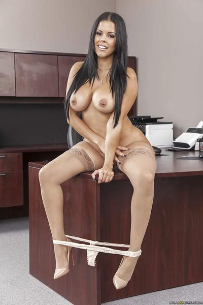 Titty secretary Diamond Kitty is posing naked on the working table