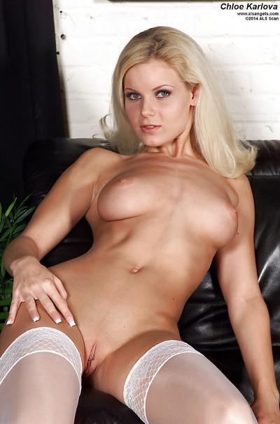 Milf blonde Chloe Karlova is smiling while posing naked on the camera