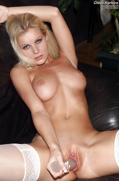 Milf blonde Chloe Karlova is smiling while posing naked on the camera