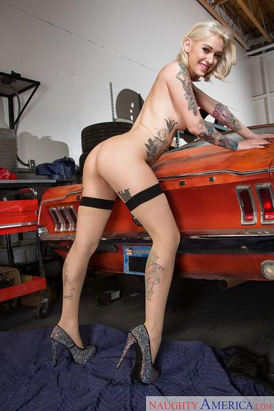Tattooed blonde punk Kleio Valentien spreading pussy on top of muscle car
