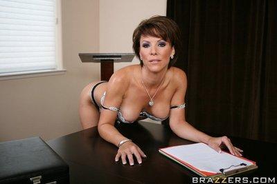 Busty MILF Kayla Synz strips off her sexy lingerie to spread her pussy