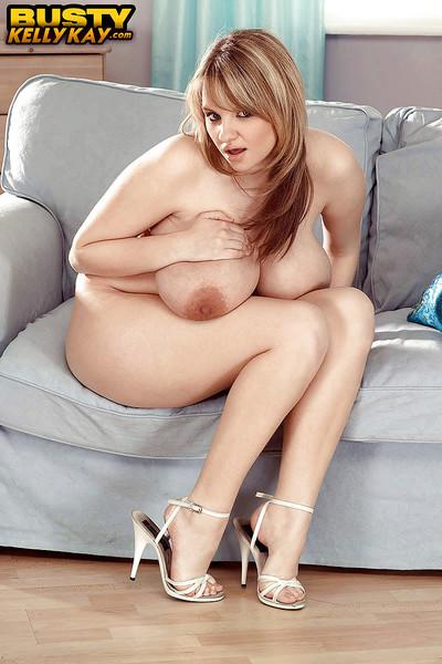 European solo girl Kelly Kay unleashing huge pornstar tits for nipple pinch