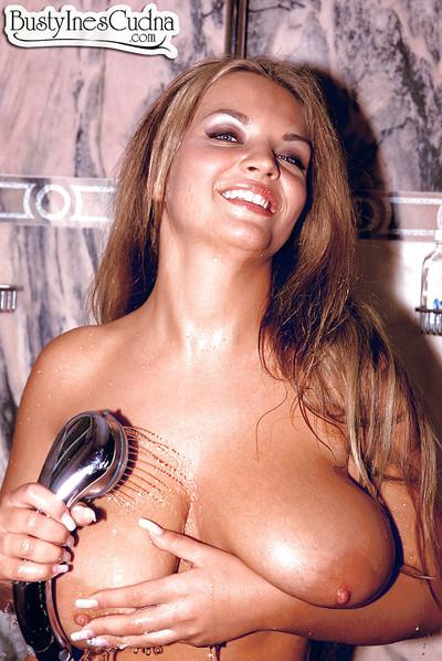 European babe Ines Cudna showering her wet MILF hooters and nipples