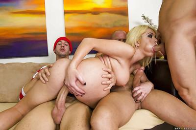 Busty gal in police uniform enjoys a gang bang action with well-hung guys