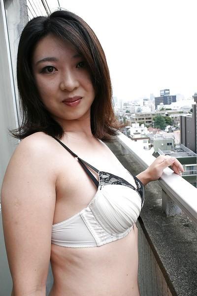 Asian MILF Naho Tajiri taking off her lingerie and toying her hairy gash