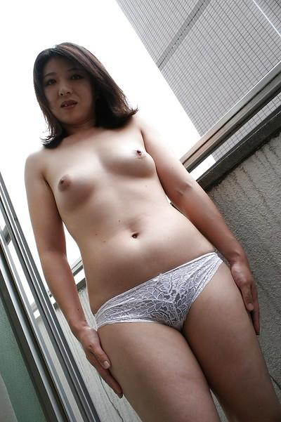Asian MILF Naho Tajiri taking off her lingerie and toying her hairy gash