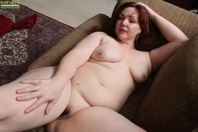 Fat redhead mom Ember Rayne revealing saggy tits and hairy vagina