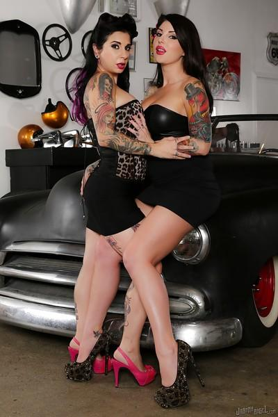 Amateur lesbian photo shoot featuring the tattooed bod of Joanna Angel