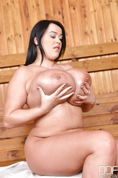 In the hot sauna plump milf Leanne Crow lets her giant hooters hang