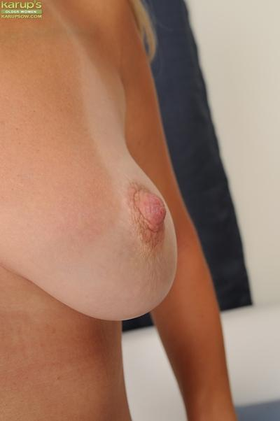 Close-up scene with blonde Chelsea Dunes that is touching her boobs