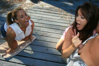 Big busted MILFs sharing a cock and getting bukkaked outdoor