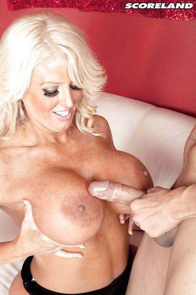 Chubby blonde MILF pornstar Alura Jenson unleashing large breasts