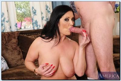 Curvy cougar Sammy Brooks gets her shaved cunt pleased by a younger lad