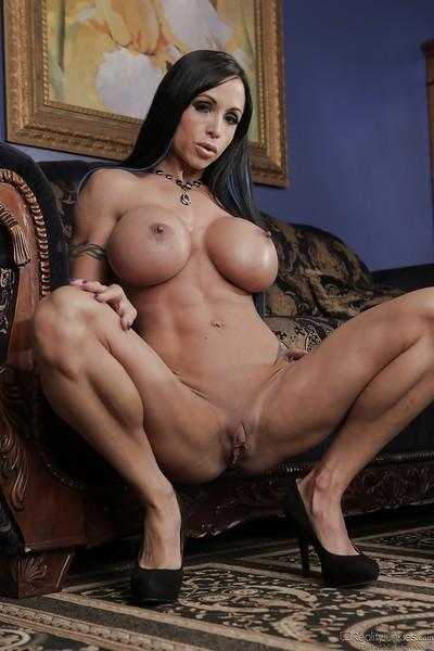 Affectionate, dark-haired milf demonstrates her unbelievably big tits