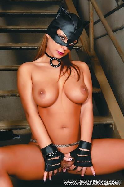 Cute catwoman with big tits Heather masturbating that shaved pussy