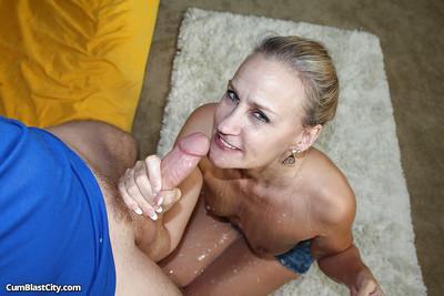 Naughty blonde MILF gives a proper handjob and receives frontal bukkake
