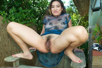 Beautiful amateur Asian MILF Leilani playing with herself outdoors