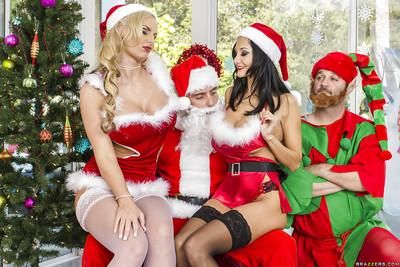 Sultry vixens get their love holes drilled hard by a hung Santa