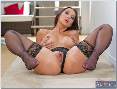 Asian MILF Katsuni strips to lingerie on high heels and flashes pussy