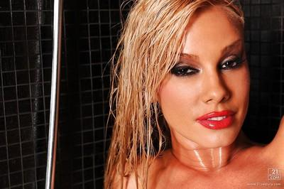 Jaw-dropping sexy blonde performs a steamy solo posing scene in shower