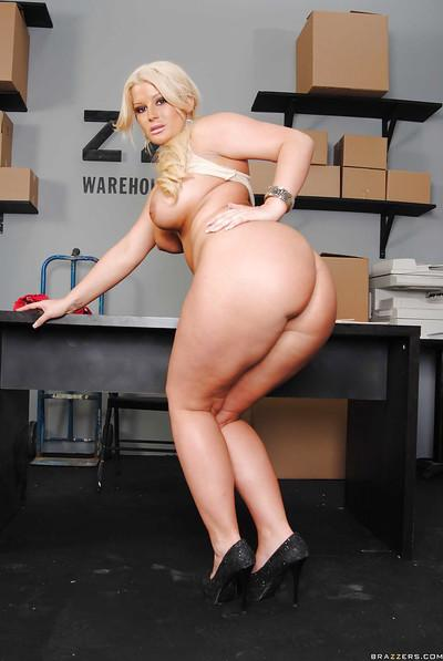 Puffy blonde exposing her huge tits and bubble butt in the warehouse