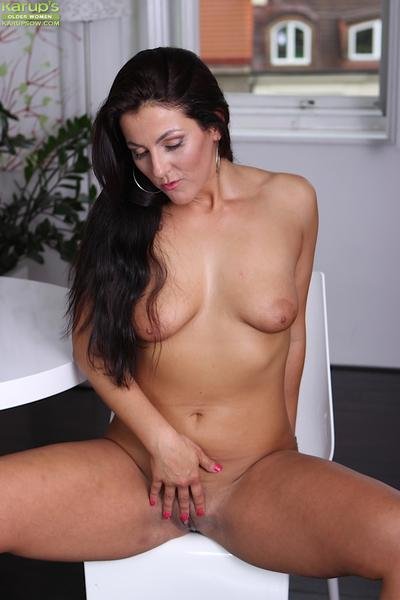Filthy brunette babe Valentina is showing her sexy body and tits