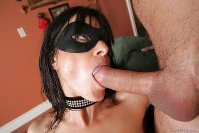 Sexy bitch with mask Cecilia Vega fucks with two tasty big poles