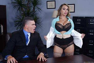 Top-heavy office slut in stockings gets shagged tough on the desk