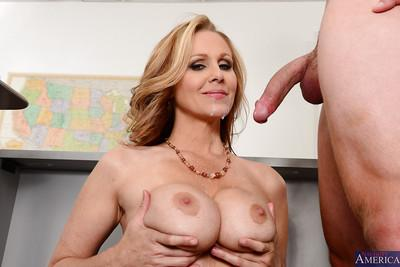 Nasty looking milf Julia is giving a stunning deep blowjob