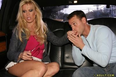 Juggy blonde cougar gets tricked into blowjob on the back seat