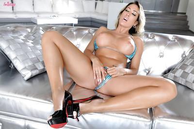 Pornstar blonde Capri Cavanni strokes her small vagina on cam