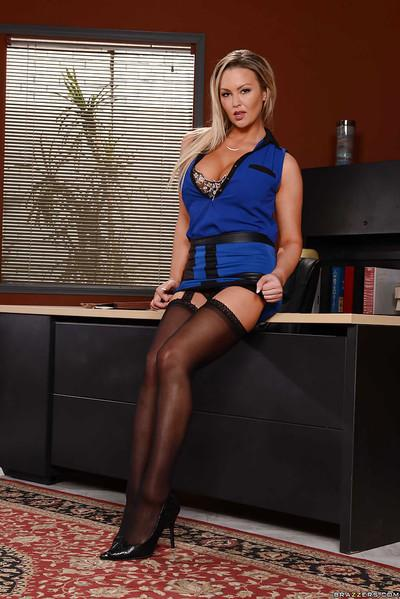 Businesswoman Abbey Brooks looking dominant in nylons and high heels