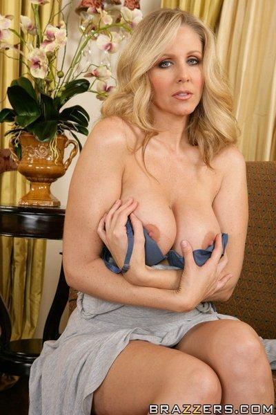 Blonde MILF wife with huge tits Julia Ann is feeling her sweet pussy