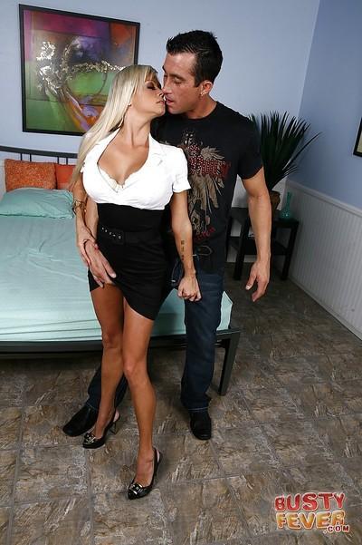 Milf blonde Nikita Von James has her big tits teased in a skirt