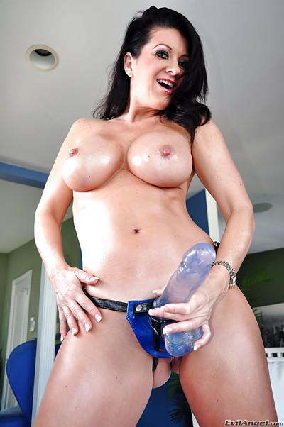 Splendid MILF in leather has her favourite sex toy ready for drilling