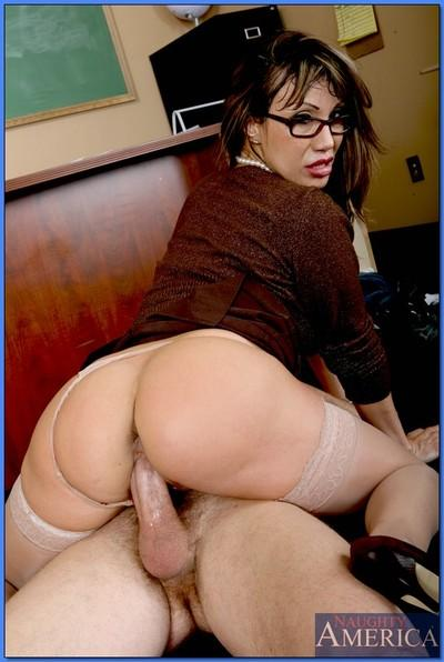 Raunchy MILF teacher Ava Devine impaled on a hard cock on her desk