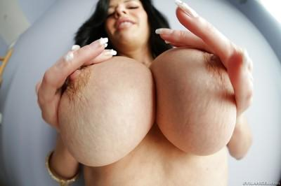 Naughty bombshell uncovering and exposing her big jugs in close up