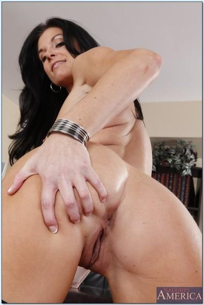 Lusty and classy MILF babe India Summer posing as a slutty teacher.