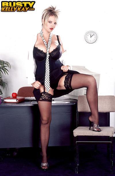 Stocking clad European MILF Kelly Kay reveals huge pornstar tits in office