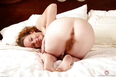 Petite redhead MILF Ana Molly baring thong covered ass and hairy beaver