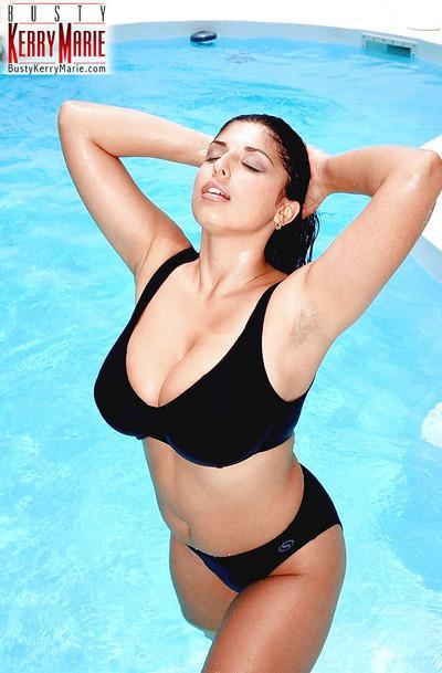 Euro plumper Kerry Marie unveils huge pornstar tits outdoors beside pool