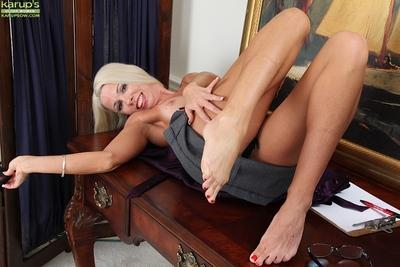 Lustful mature blonde getting nude and showing off her cunt in close up