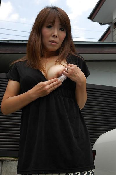 Frisky asian MILF Kayo Mukai undressing and spreading her legs outdoor