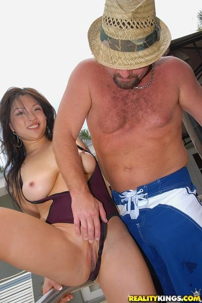Baring Asian milf boobs and fucking Asian milf pussy in pool