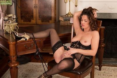 Sexy MILF Crystall Anne posing in pantyhose, garters and high heels