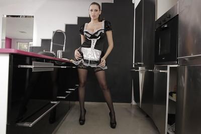 Busty Euro maid Sensual Jane posing in black nylons and high heels