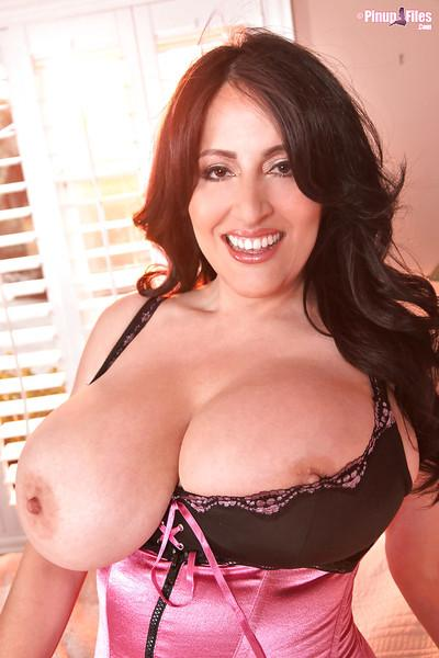 Buxom Latina Antonella Kahllo unleashing massive melons from corset