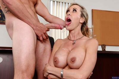 Milf secretary Brandi Love has her mouth fucked hard in the office